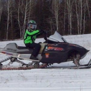 "My 10 year old son Alex on the 144"" 2002 Mountain Cat 800"